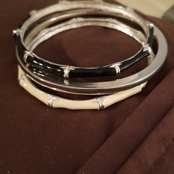 Jewelry - 3 bracelets.  Silver, black and cream colored